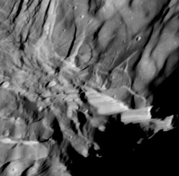 Verona Rupes, about 50 km (31 miles) long and several km high, but not actually so cliff-like as it ...
