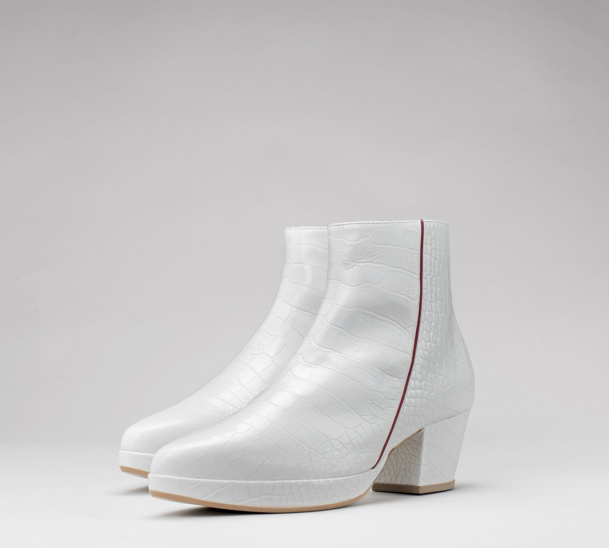Anubis Scarabeus Ankle Boots in White from Rani Bageria.
