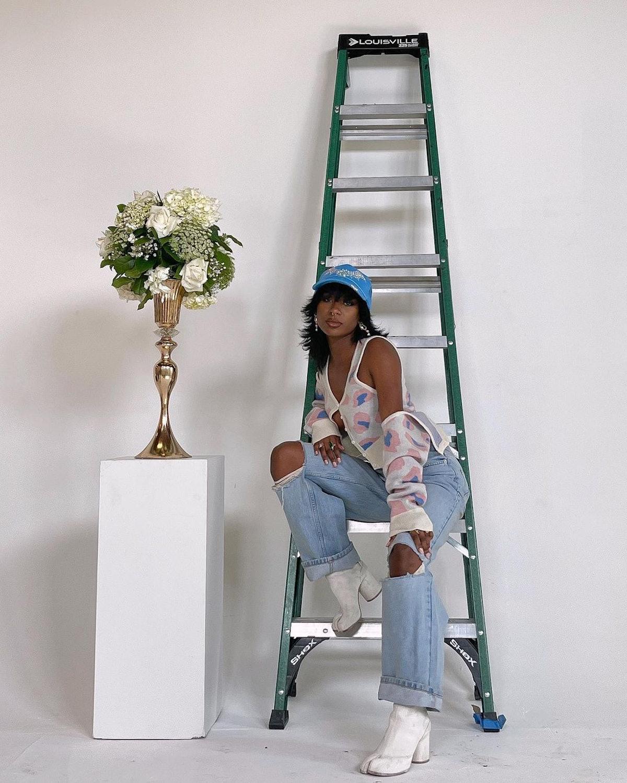 Digital creator and influencer Cierra Nia wears Maison Margiela white Tabi boots in her Instagram po...