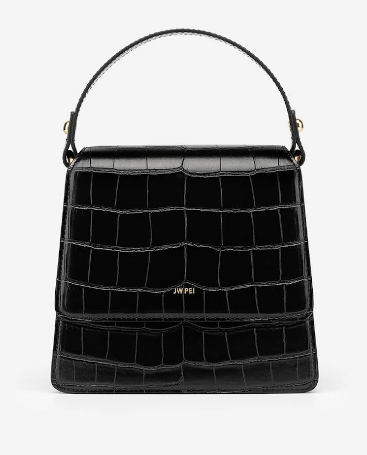JW PEI's The Fae Top Handle bag in black croc.