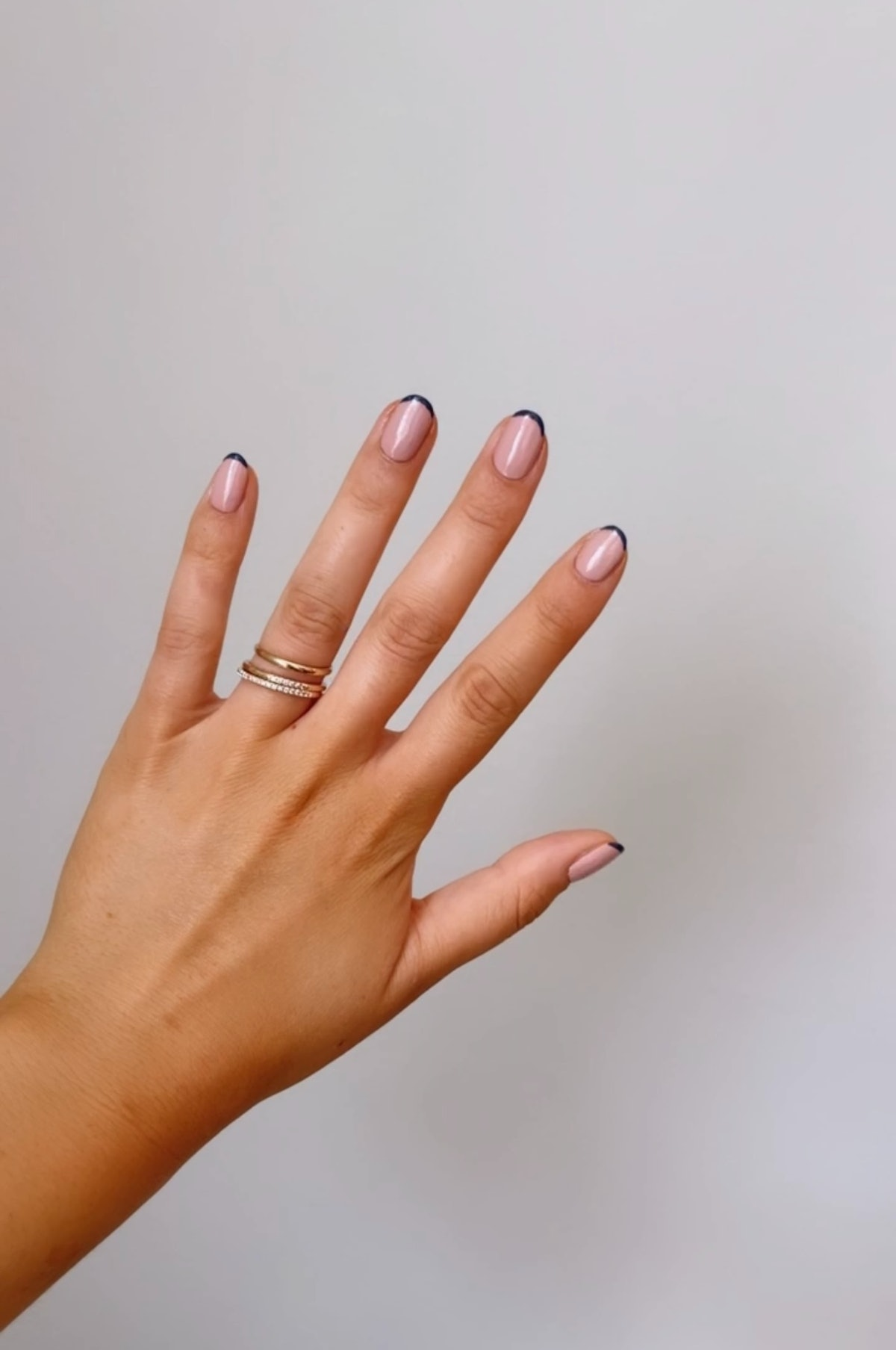 A navy blue French manicure is one of fall 2021's biggest nail trends as a twist on the classic Fren...