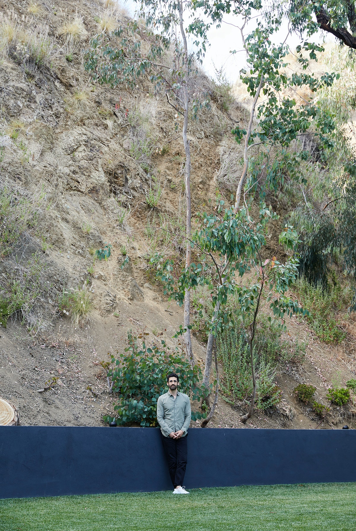 Kordansky in his backyard, against the hills of Griffith Park.