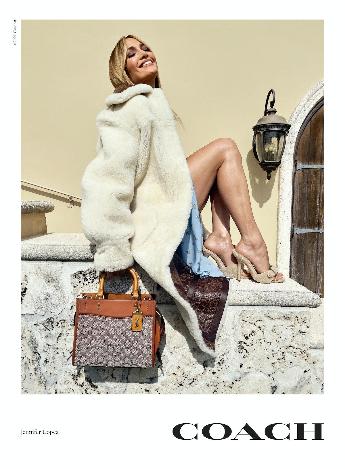 Jennifer Lopez stars in Coach's new Rogue bag campaign, carrying a Rogue 25 handbag in signature tex...