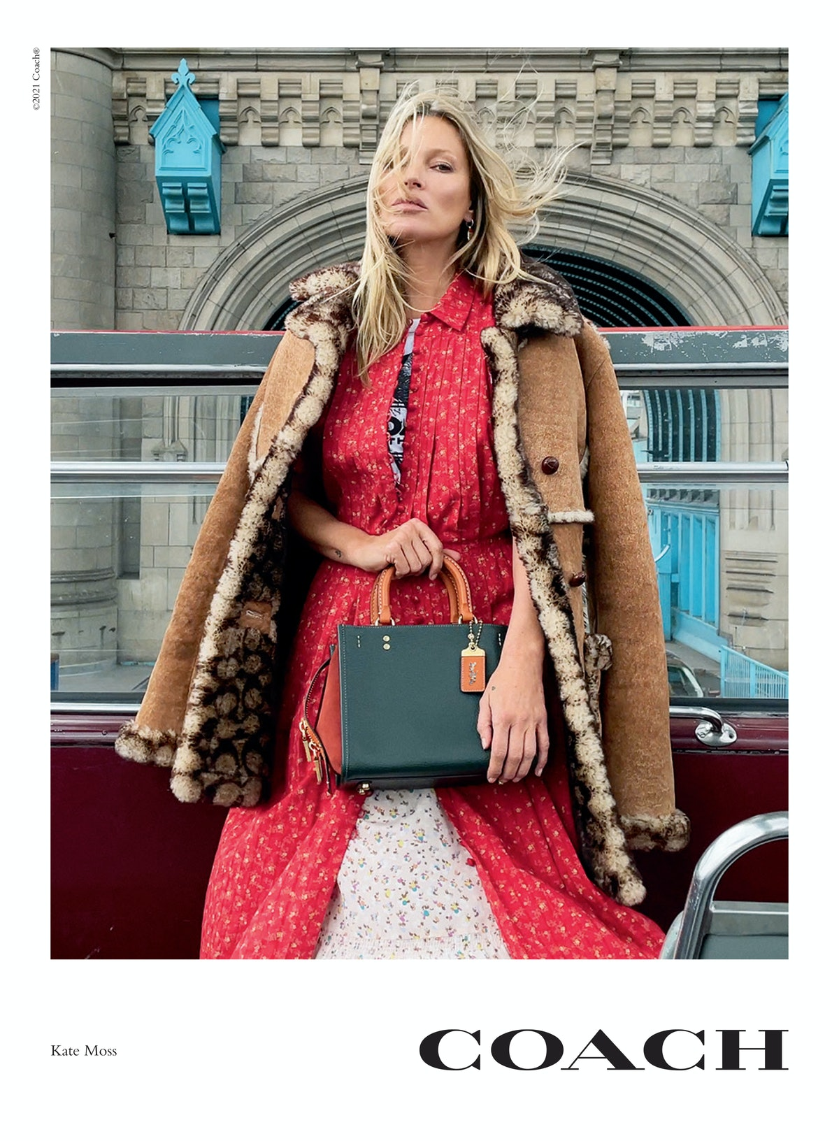 Kate Moss stars in Coach's new Rogue bag campaign, carrying a Rogue 25 handbag in green and orange c...
