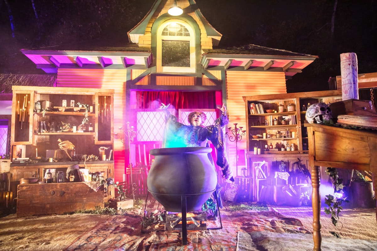 Winifred Sanderson stands in her cottage at Freeform's Halloween Road, which features photo ops from...