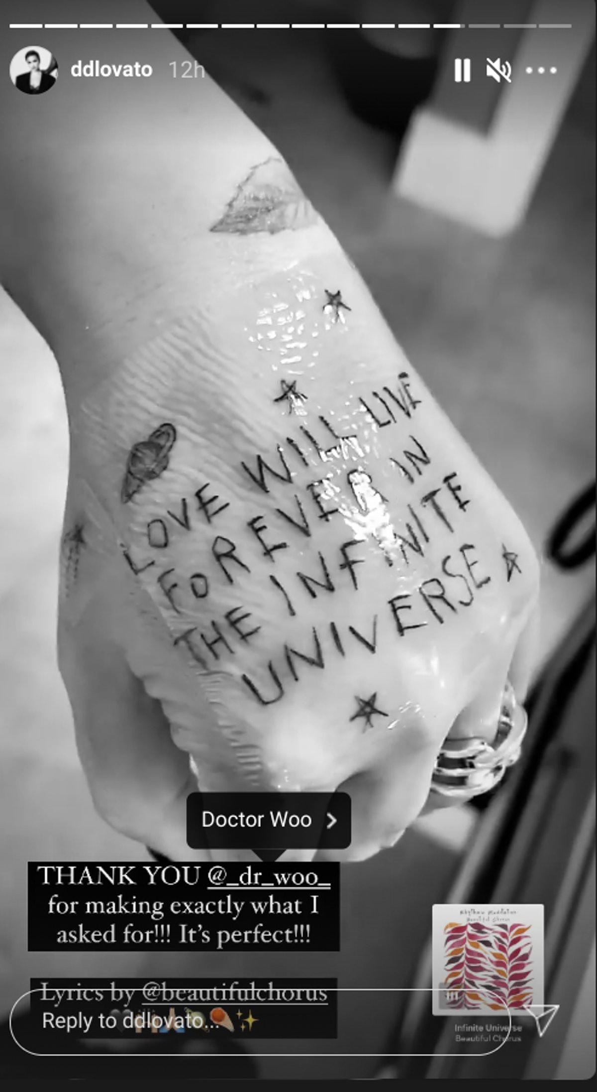 """A close up on Demi Lovato's new hand tattoo which was inspired by Beautiful Chorus' """"Infinite Univer..."""