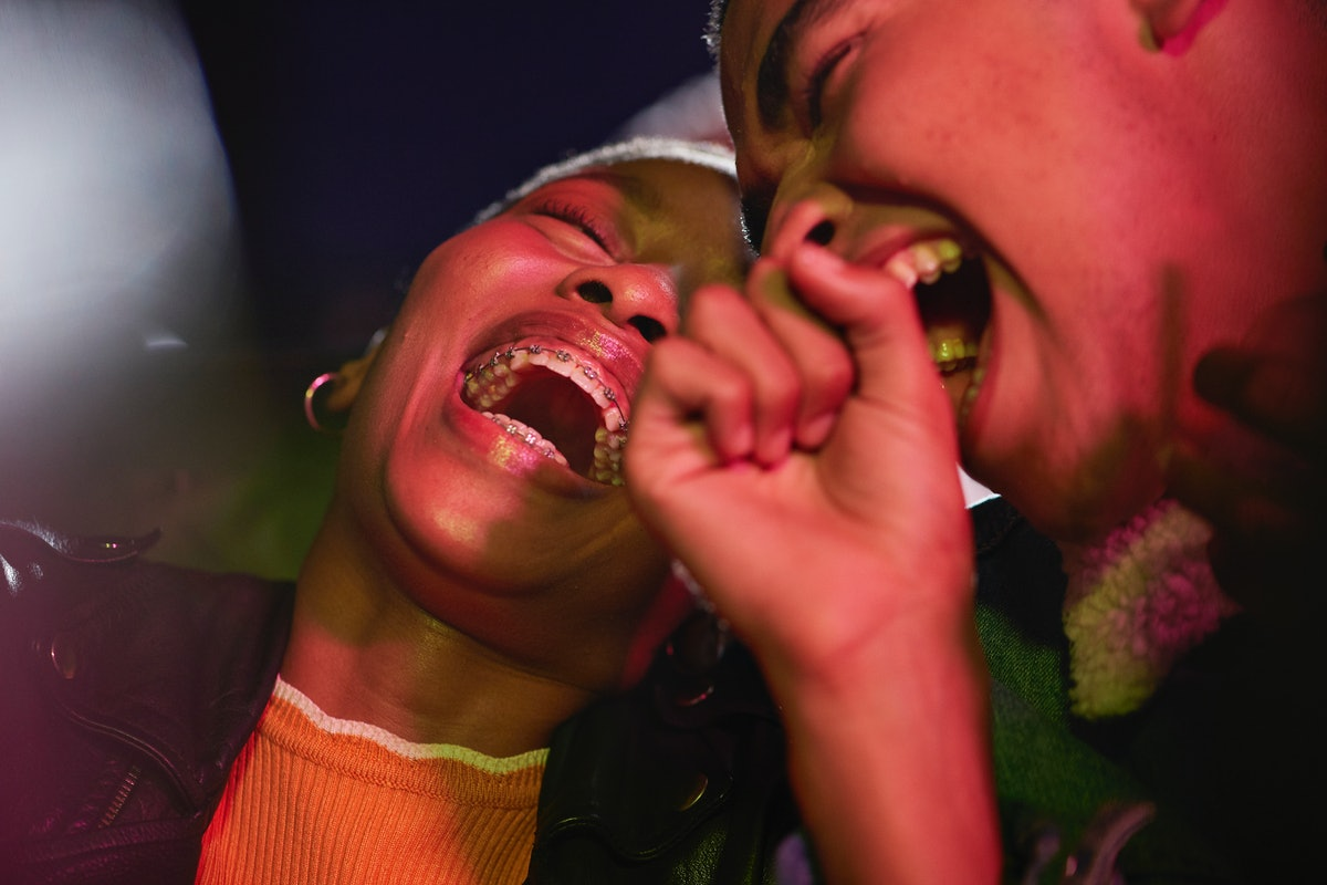 A young couple laughing and celebrating how September 2021 will be the best month for their zodiac s...