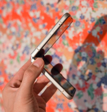 Galaxy Z Flip 3 review: The foldable phone bending in half and unfolding.