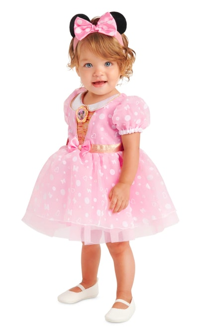 Little girl wearing pink dress and Minnie Mouse ears