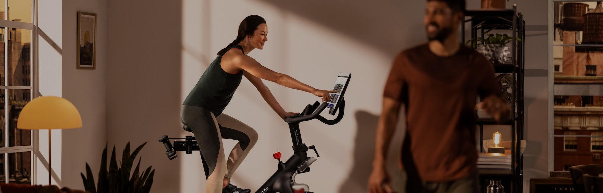 A woman riding a Peloton bike