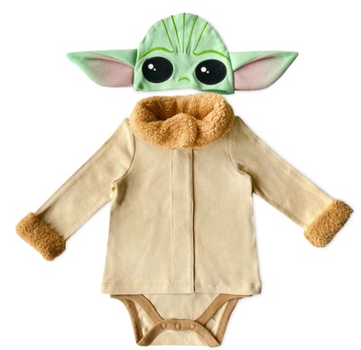 Flat lay of baby onesie and hat that looks like Baby Yoda