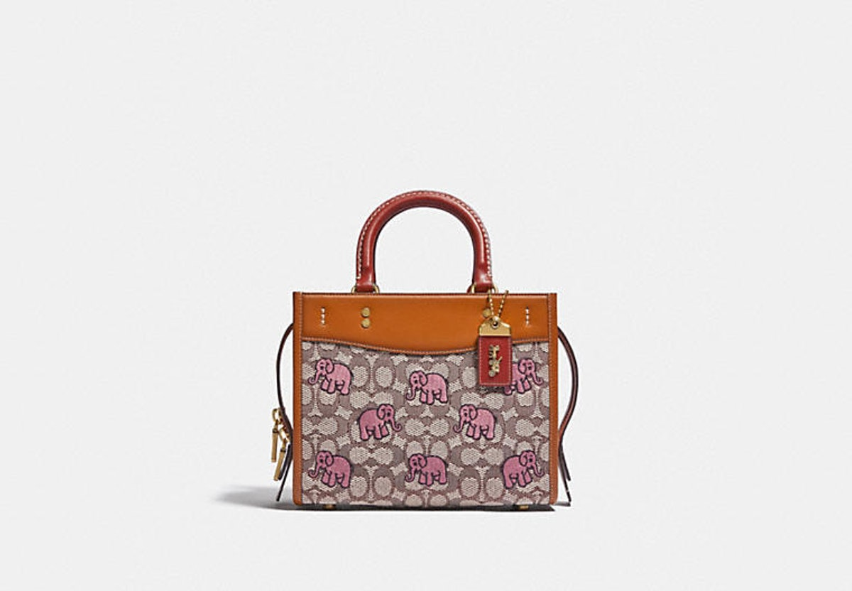 Coach Rogue 25 bag in Signature Textile Jacquard With Embroidered Elephant Motif.