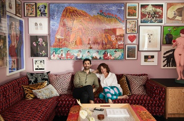 Kordansky  and Shapero in the TV room, beneath Maija Peeples-Bright's Giraffe Gibraltar With Gecko G...