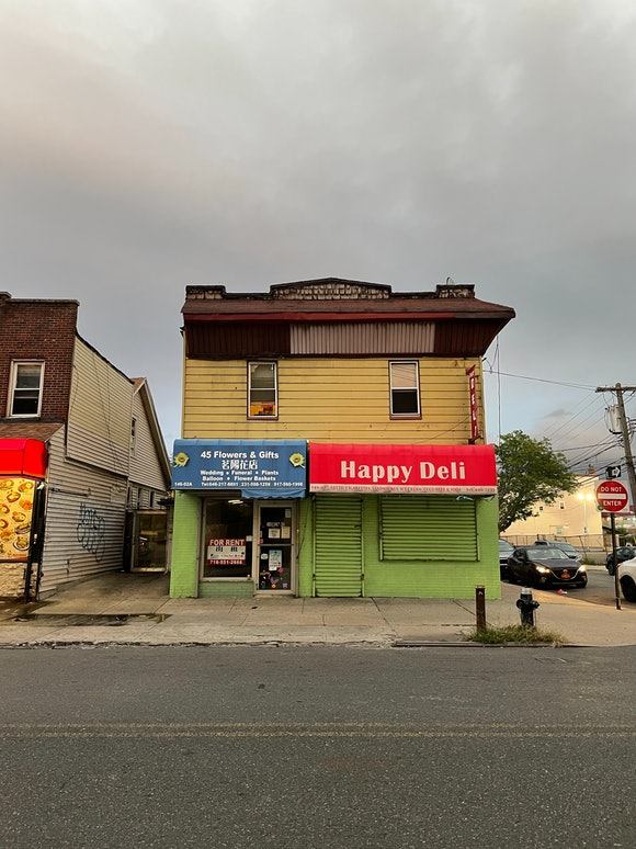 Galaxy Z Flip 3 vs. iPhone 12 Pro camera color comparison: street photo of restaurants
