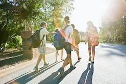 group of kids walking wearing colorful backpacks