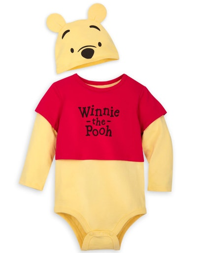 Flay lay of baby onesie and hat that look like Winnie the Pooh
