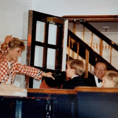 Princess Diana hugs William.