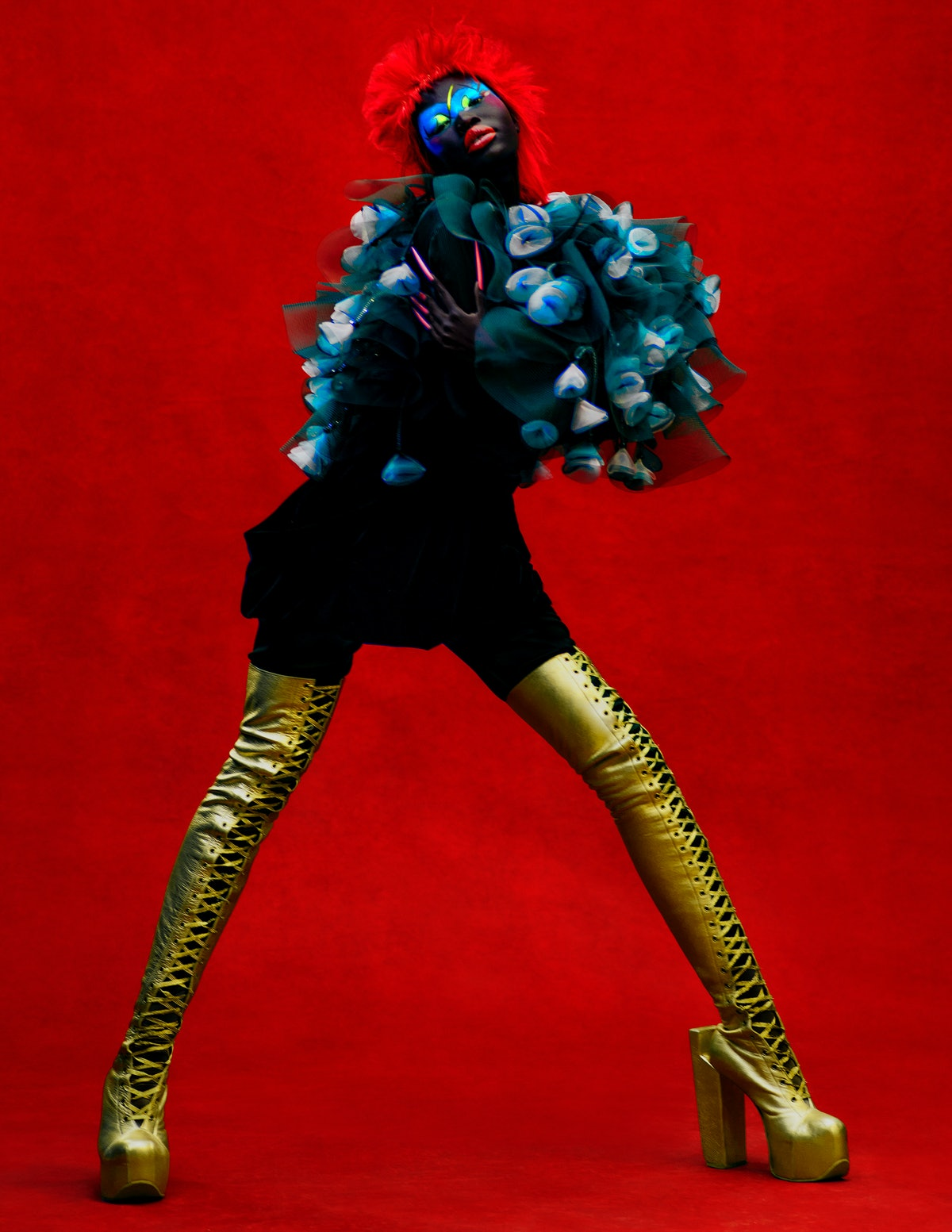 Adhel Bol wears a Giorgio Armani cape and skirt; Natacha Marro boots.