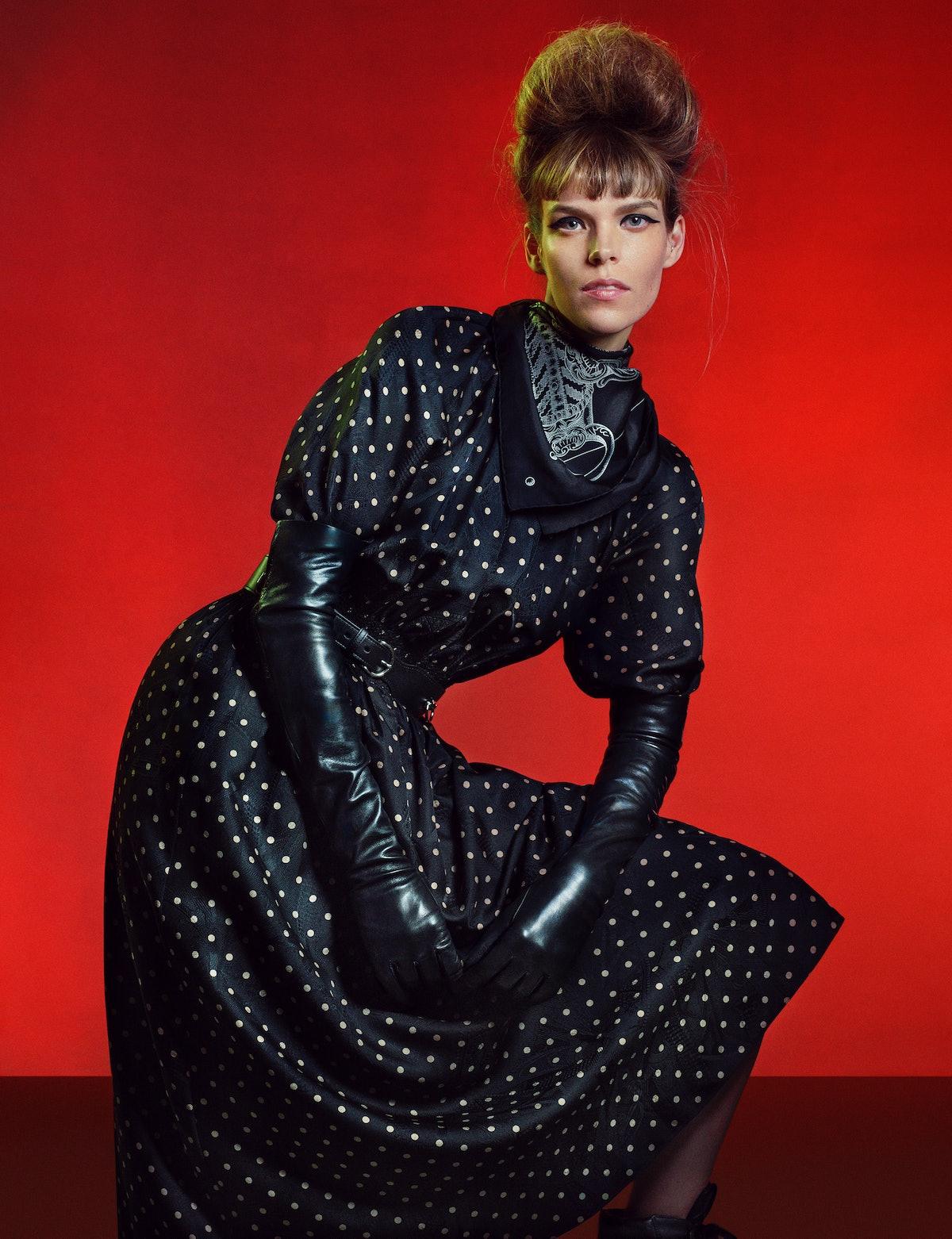 Meghan Collison wears an Hermès dress, scarf, and belt; Miu Miu boots; stylist's own gloves.