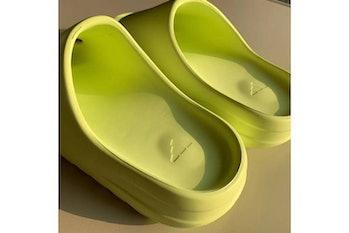 Kanye West Yeezy slides glow green