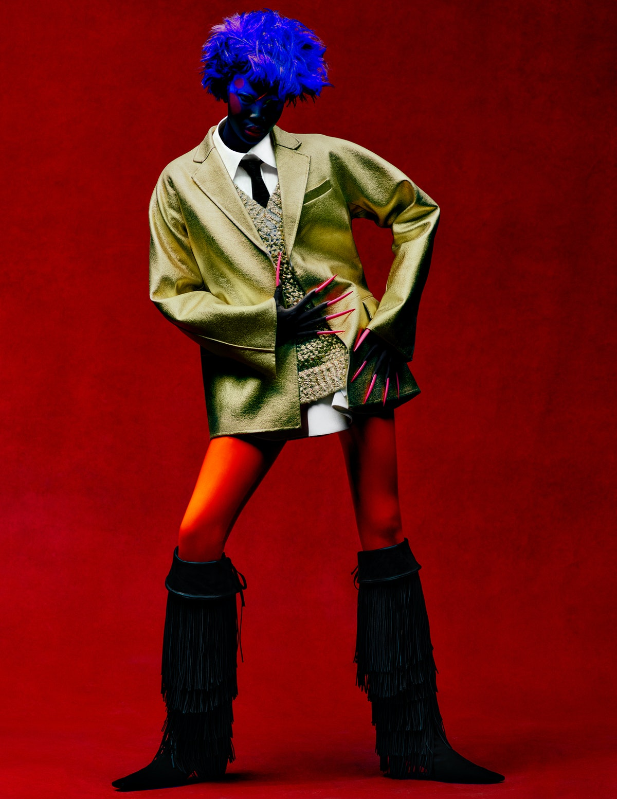 Adhel Bol wears a Valentino jacket, sweater, and shirt; Roger Vivier boots; stylist's own tie.