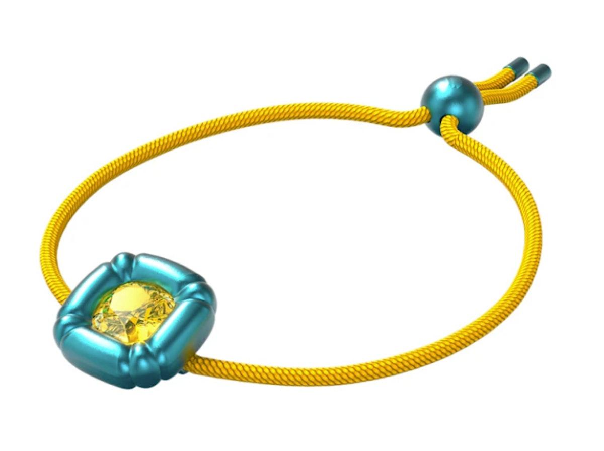 Swarovski's Dulcis bracelet with a cushion cut blue crystal.