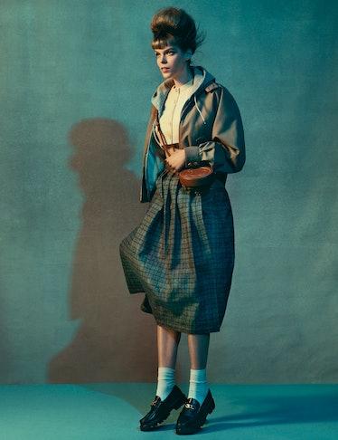 Model Meghan Collison wears a Celine by Hedi Slimane jacket, hoodie, cropped cardigan, skirt, bag, a...