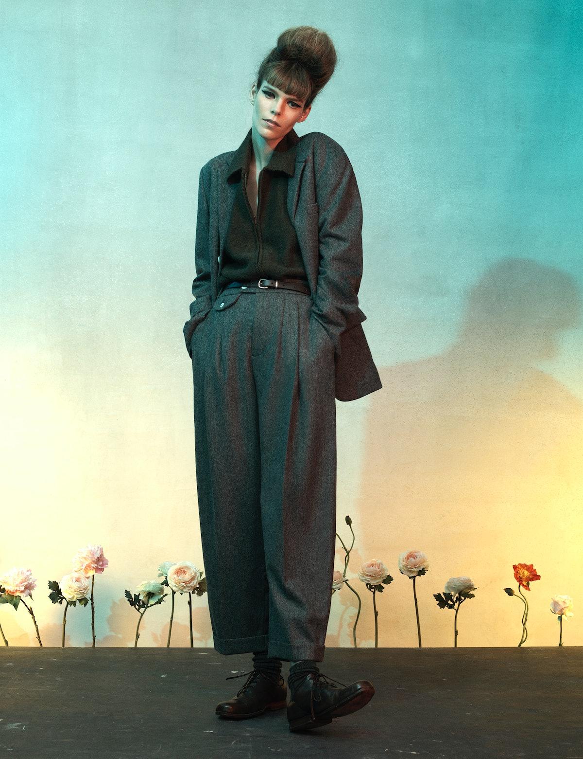 Meghan Collison wears a Zanini jacket, sweater, pants, belt, and shoes; Falke socks.
