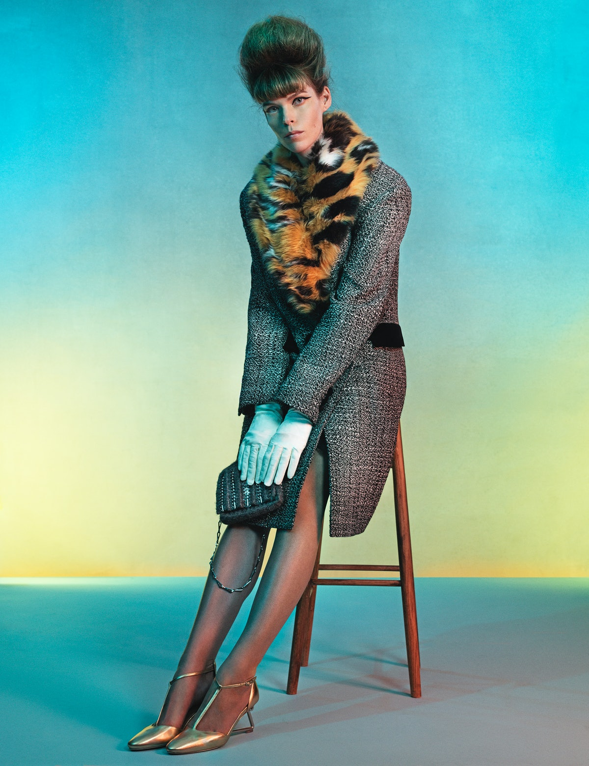 Meghan Collison wears a Paco Rabanne coat with detachable collar, bag, and shoes; stylist's own glov...