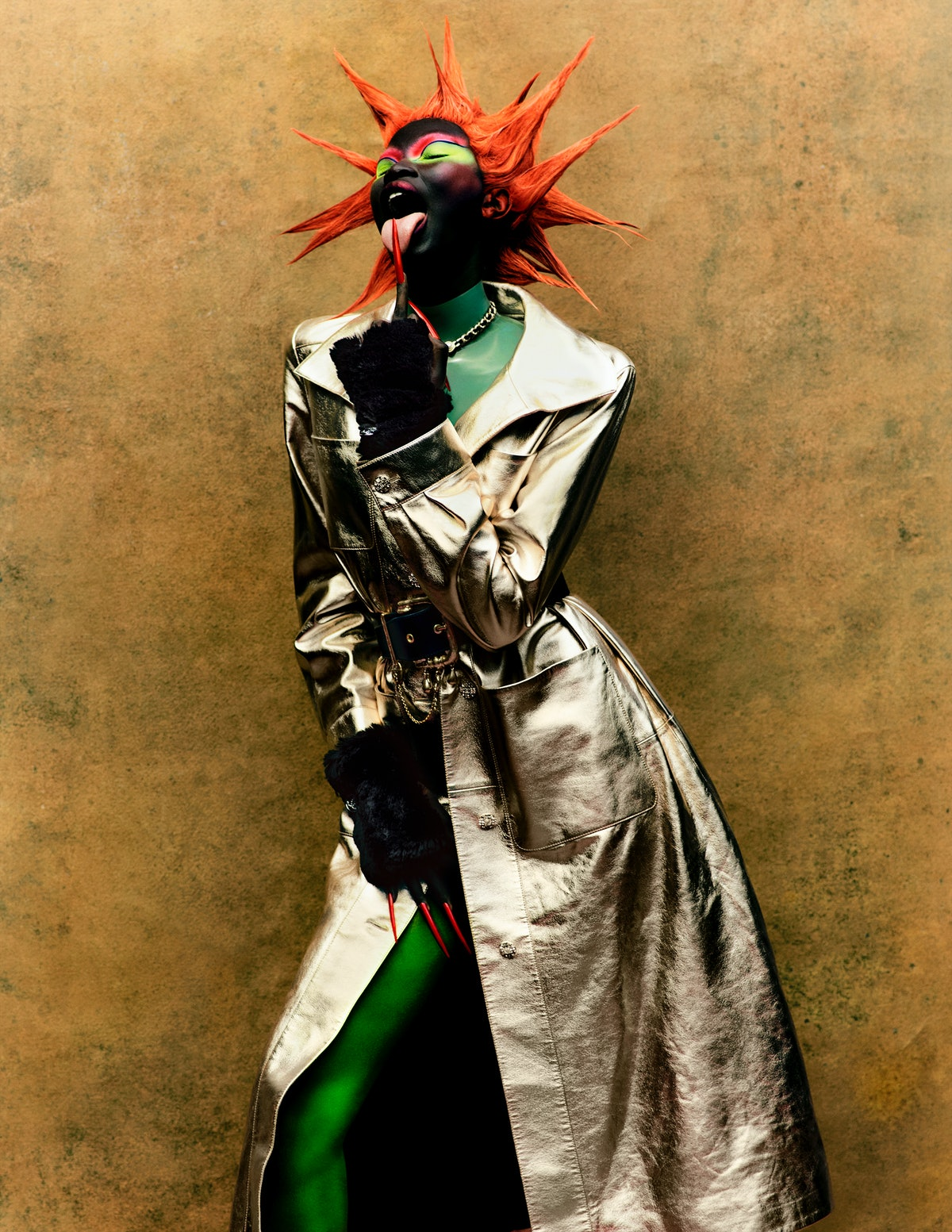Adhel Bol wears a Chanel coat, necklace, and gloves; Atsuko Kudo top; Schiaparelli belt.