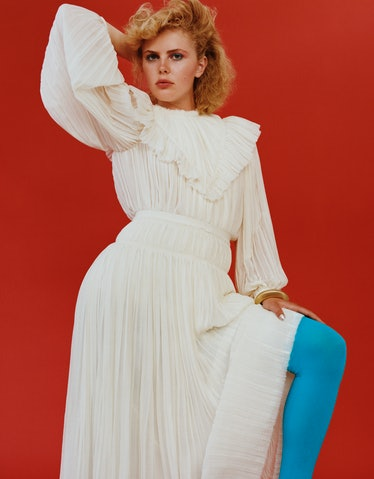 Florence wears a Chloé top and skirt; bracelet from Jennifer Gibson Jewellery; stylist's own tights.