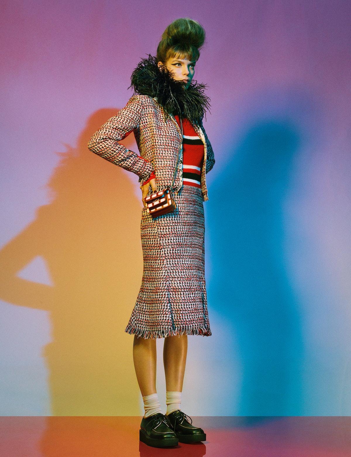 Meghan Collison wears a Marni jacket, sweater, skirt, bag, socks, and shoes; stylist's own neckpiece...