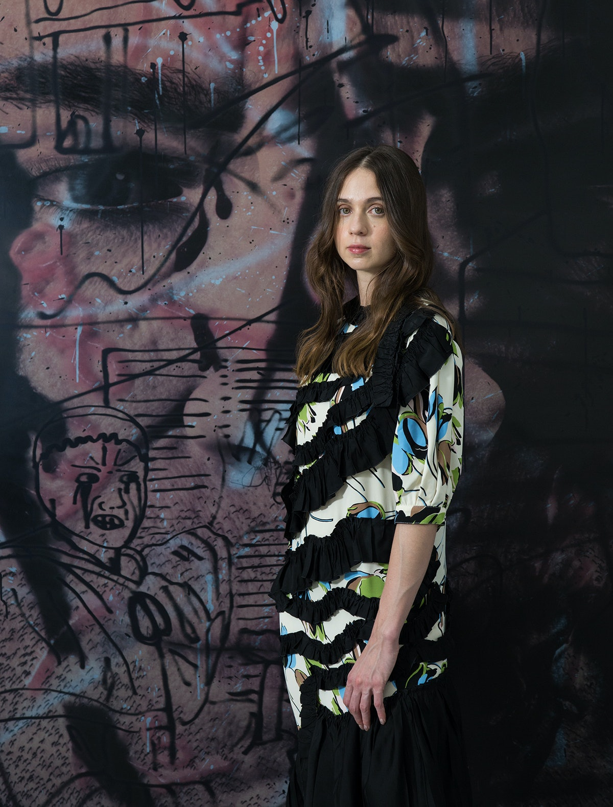 """Avery Singer, wearing a Marni dress, in front of her painting """"The Edgelord,"""" 2021."""