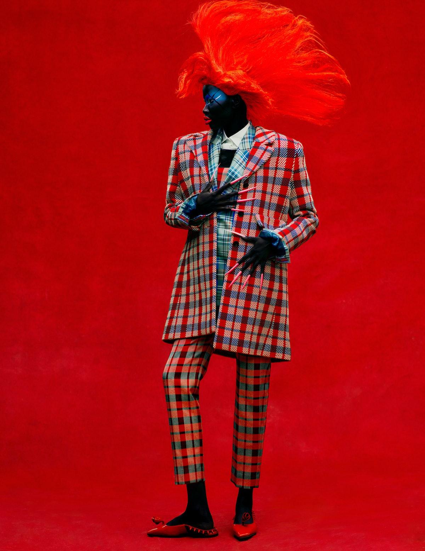 Adhel Bol wears a Dior coat, corset, shirt, pants, and shoes; Charles Jeffrey Loverboy jacket and ve...