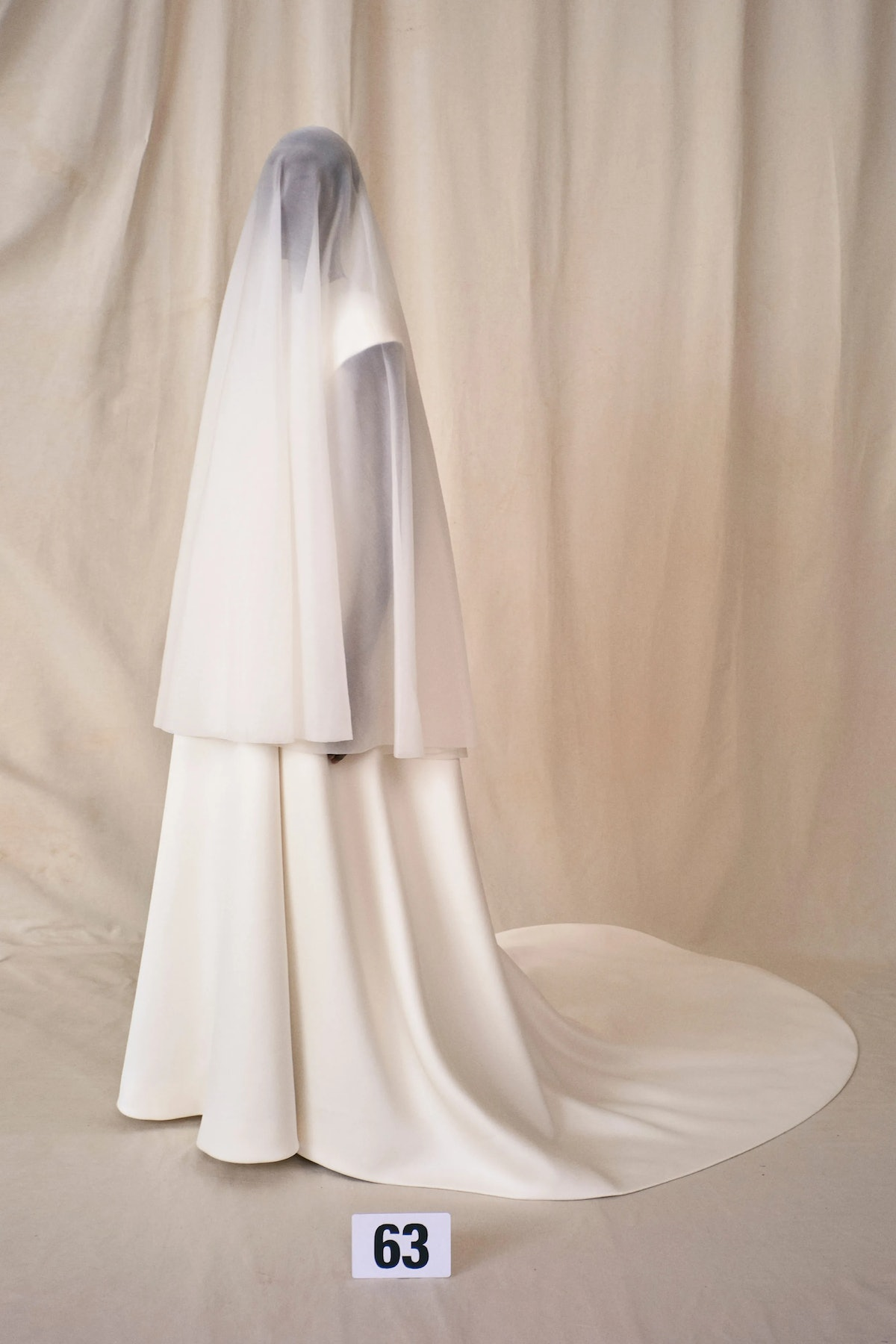 Model wears a wedding dress from Balenciaga Couture Fall 2021 collection.