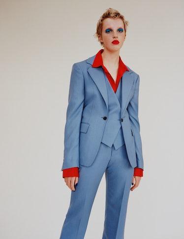 Flo Nicholls wears a Vivienne Westwood  waistcoat jacket and pants; Marine Serre shirt.