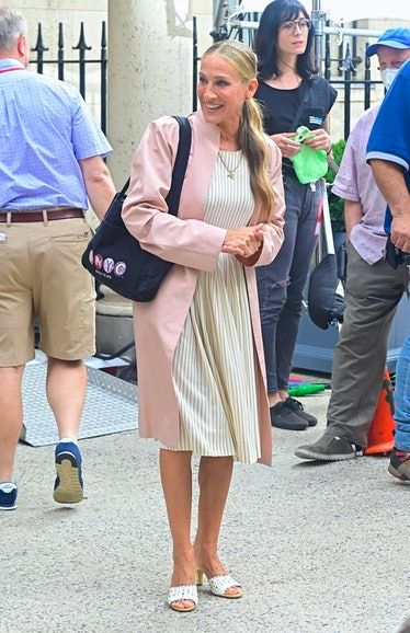 Carrie Bradshaw in pink coat.