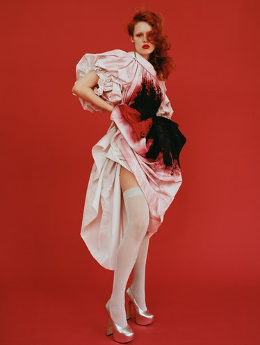 Liv Walters wears an Alexander McQueen dress; vintage earrings from Rewind Vintage; Vivienne Westwoo...