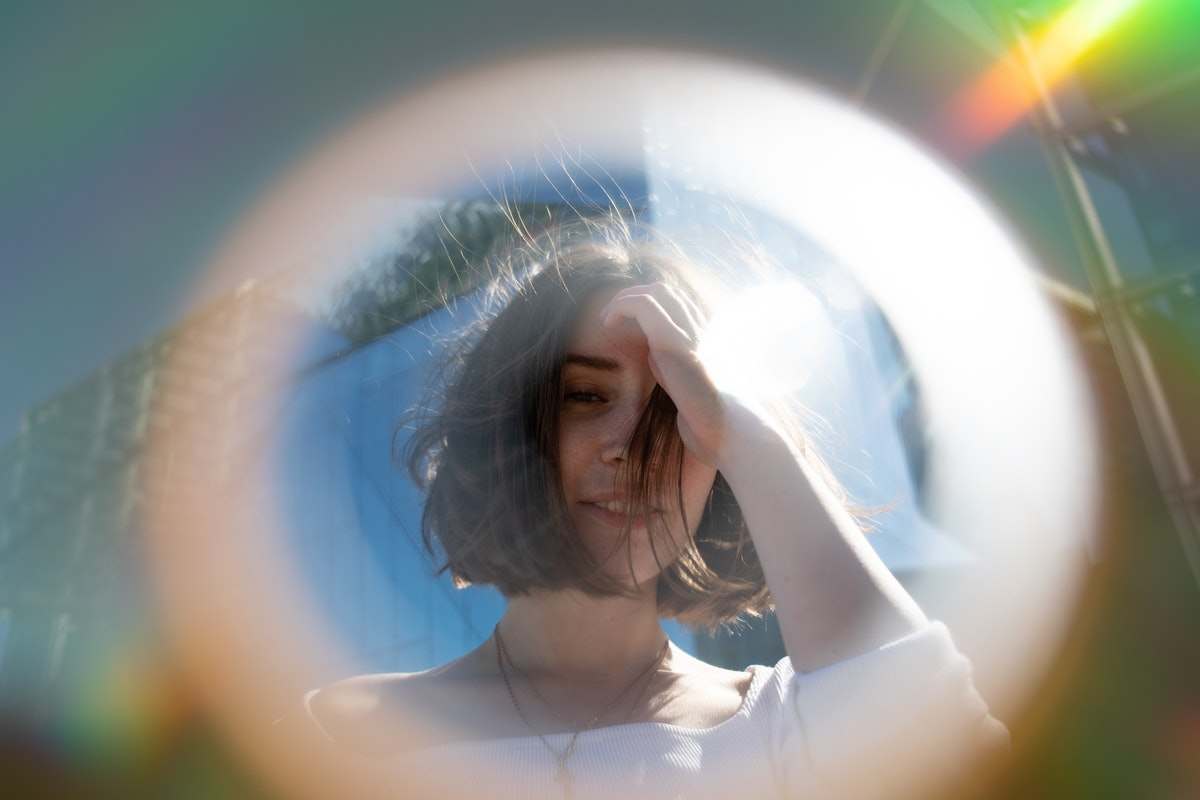 Close-Up Portrait Of Woman Seen Through Circle Shape, having the best week of August 30, 2021, per h...