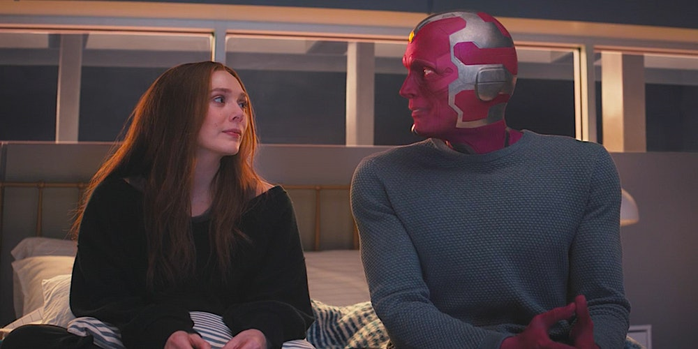 Wanda and Vision sit next to each other during a flashback in WandaVision