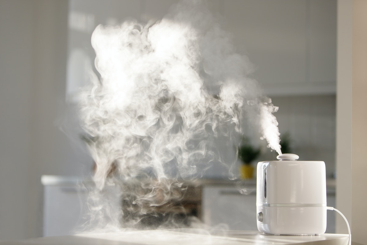 Air humidifier on table to show the benefits of sleeping with one at night.