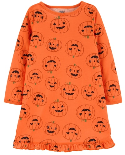 Image of an orange toddler nightgown with pumpkins on it.
