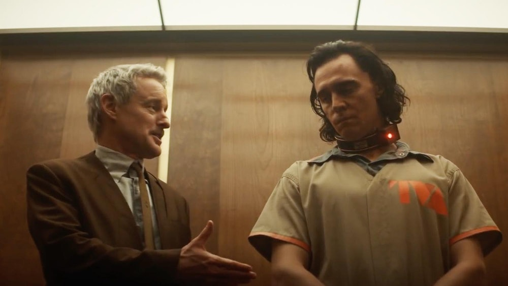 Mobius talks to Loki in a TVA elevator in Loki episode 1
