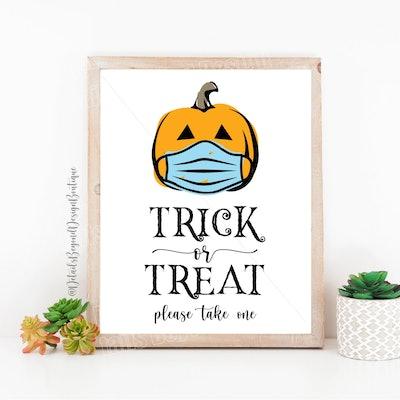 please take one halloween sign-masked pumpkin