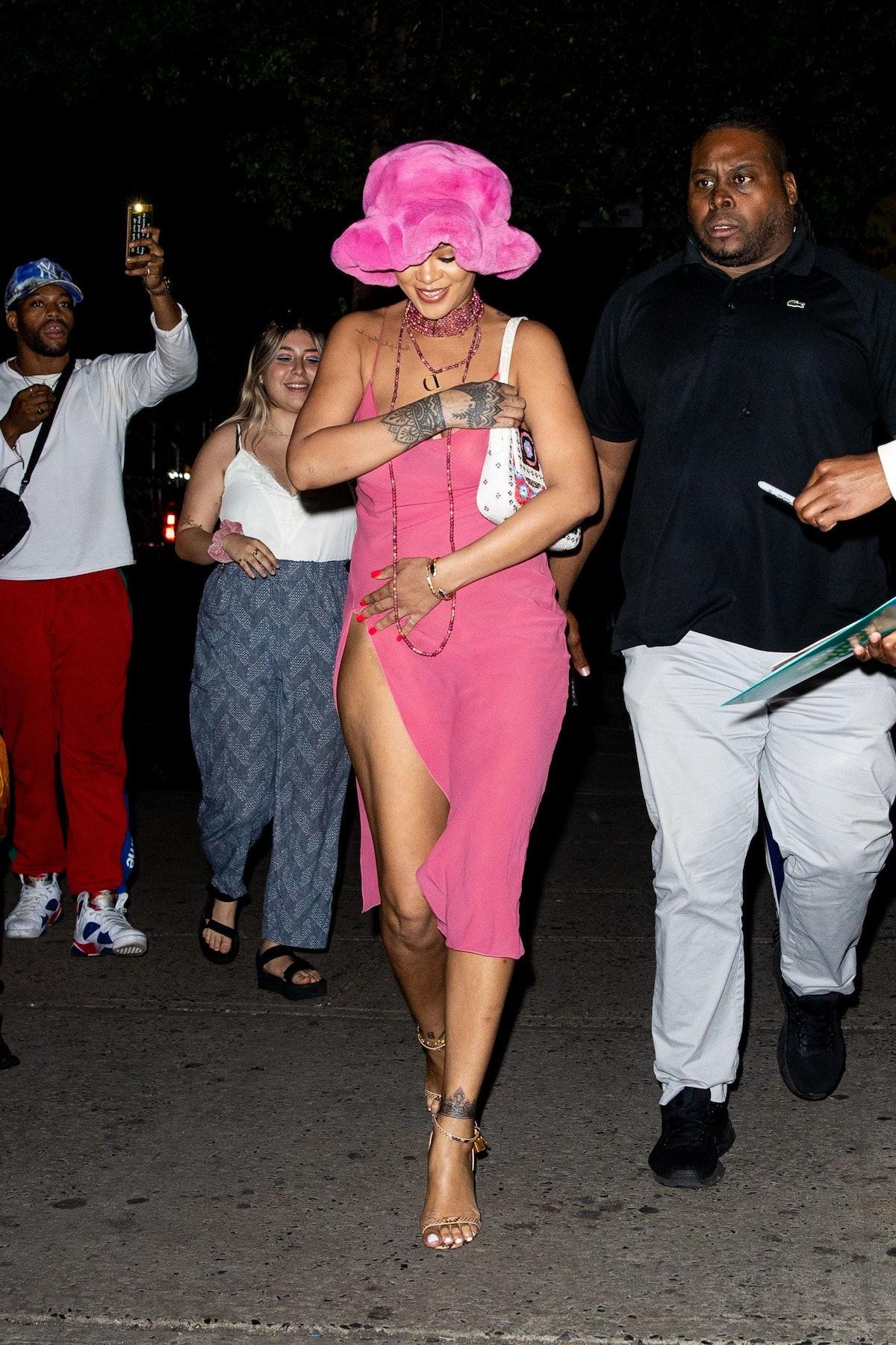 Rihanna wearing a pink bucket hat