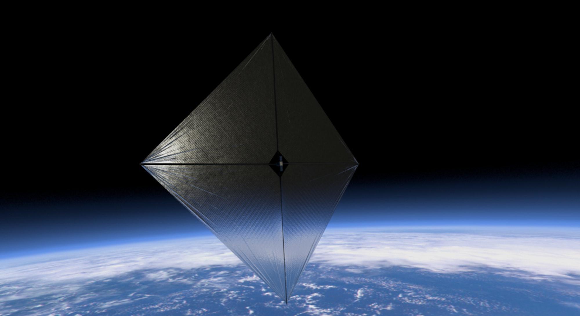 A metallic sun sail floating above Earth