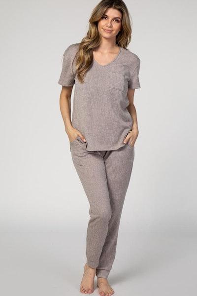 Woman in mocha PJ set; tee shirt and skinny pants
