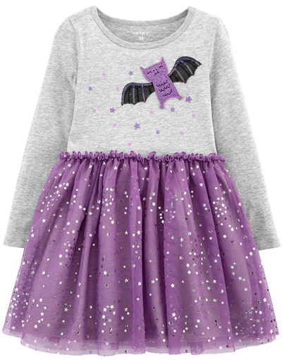 Image of a toddler dress with a bat on its top, and a purple tutu skirt bottom.