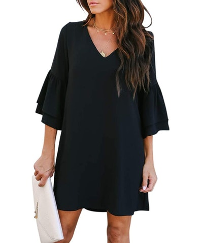 Woman modeling knee-length black dress with 3/4 length bell sleves