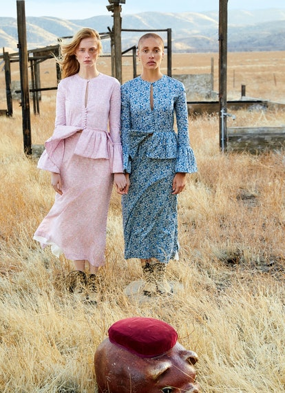 the models Rianne van Rompaey and Adwoa Aboah wearing matching floral outfits in a field